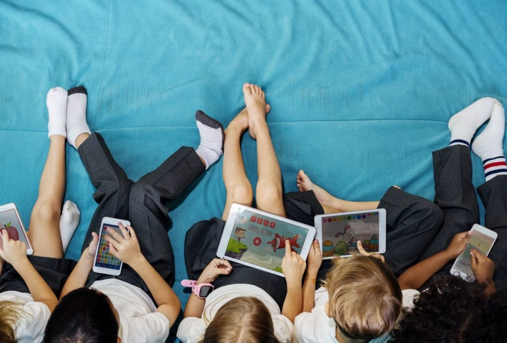 Children using phone and devices