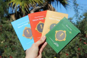 close up of hand holding four nature passports
